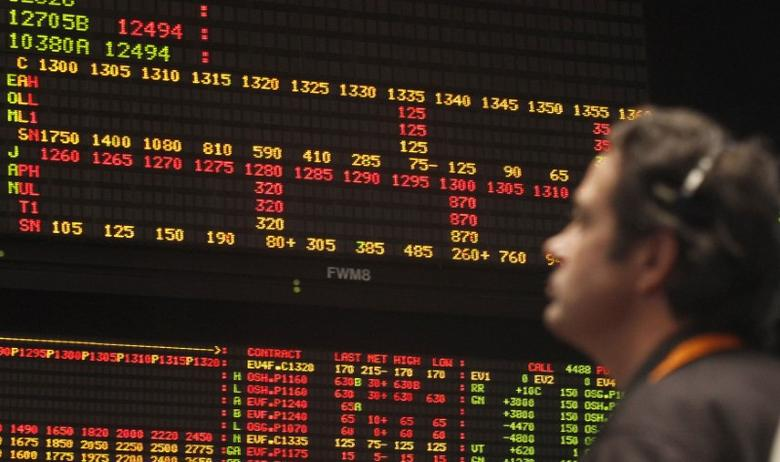 A trader looks at an order board in Chicago, January 25, 2012.  REUTERS/Frank Polich