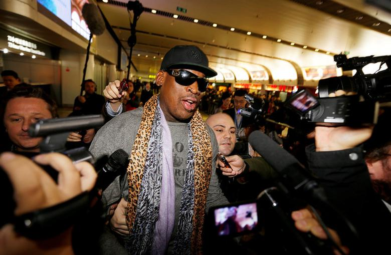 FILE PHOTO: Former NBA basketball player Dennis Rodman speaks to the media after returning from his trip to North Korea at Beijing airport, December 23, 2013. REUTERS/Jason Lee/File Photo