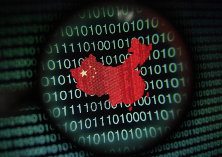 A map of China is seen through a magnifying glass on a computer screen showing binary digits in Singapore in this January 2, 2014 photo illustration. REUTERS/Edgar Su/File Photo
