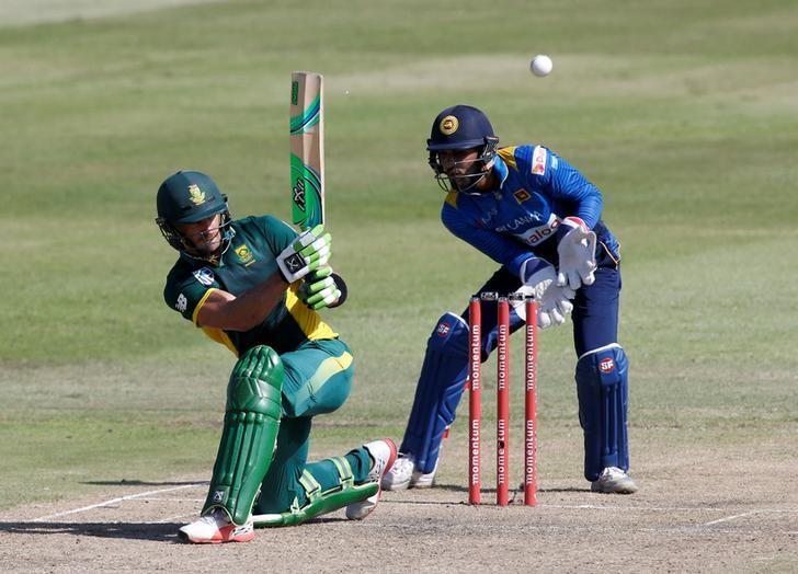Cricket - South Africa v Sri Lanka - Second One Day International cricket match - Kingsmead Stadium, Durban, South Africa - 1/2/17 - South Africa's Faf du Plessis plays a shot as Sri Lanka's Dinesh Chandimal looks on. REUTERS/Rogan Ward