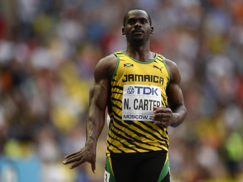 Nesta Carter of Jamaica reacts after winning his men's 100 metres heats during the IAAF World Athletics Championships at the Luzhniki stadium in Moscow August 10, 2013. REUTERS/Dylan Martinez