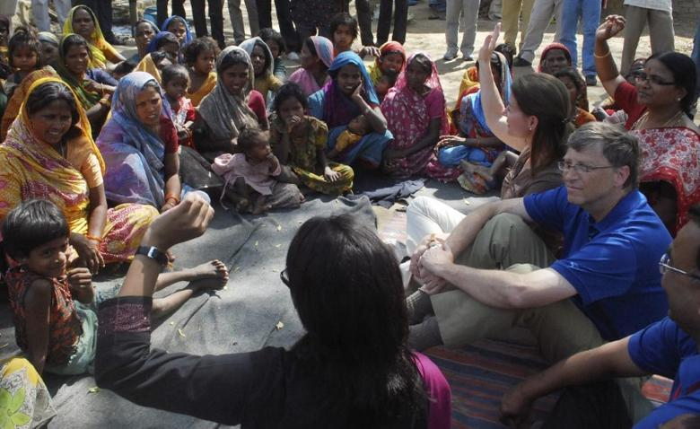 Microsoft Corp co-founder Bill Gates and his wife Melinda interact with slum dwellers during their visit to a slum area in Danapur near the eastern Indian city of Patna March 23, 2011. REUTERS/Krishna Murari Kishan