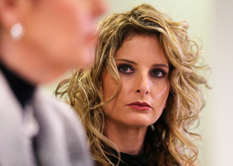 FILE PHOTO - Summer Zervos listens as her attorney Gloria Allred speaks during a news conference announcing the filing of a lawsuit against President-elect Donald Trump in  Los Angeles, California, U.S., January 17, 2017.  REUTERS/Mike Blake