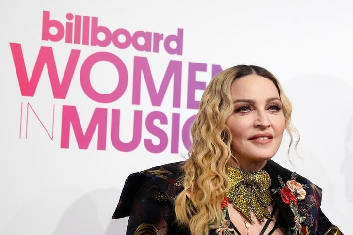 Madonna poses on the red carpet a the Billboard Magazine's 11th annual Women in Music luncheon in New York, U.S., December 9, 2016.  REUTERS/Shannon Stapleton