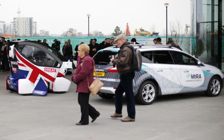 People view prototypes of a driverless vehicles in Greenwich, east London, February 11, 2015.   REUTERS/Suzanne Plunkett