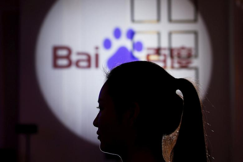 FILE PHOTO: A woman is silhouetted against the Baidu logo at a new product launch from Baidu, in Shanghai, China, November 26, 2015. REUTERS/Aly Song/File Photo