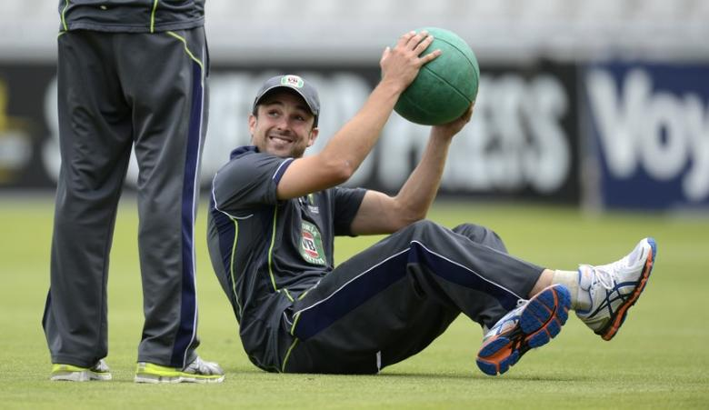 Australia's Ed Cowan smiles during a training session before Thursday's third Ashes cricket test match against England at Old Trafford cricket ground in Manchester July 30, 2013. REUTERS/Philip Brown/File Photo