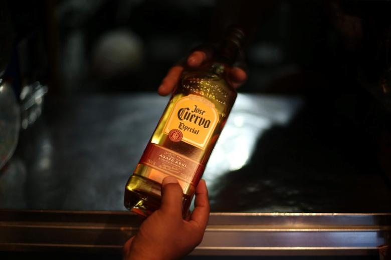 A man receives a bottle of Jose Cuervo Tequila in Mexico City, Mexico, February 8, 2017.  REUTERS/Edgard Garrido