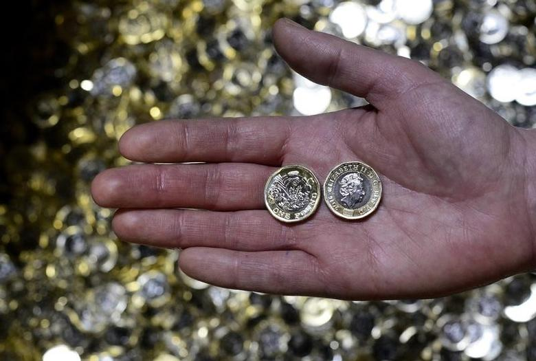 New one pound coins are displayed The Royal Mint, in Llantrisant, Wales, Britain, January 25, 2017. Picture taken January 25, 2017. REUTERS/Rebecca Naden