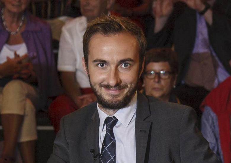 Jan Boehmermann, host of the late-night ''Neo Magazin Royale'' on the public ZDF channel is pictured during a TV show of Markus Lanz in Hamburg, Germany, August 21, 2012.  REUTERS/Morris Mac Matzen