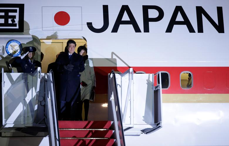 Japanese Prime Minister Shinzo Abe and his wife Akie Abe arrive ahead of his meeting with U.S. President Donald Trump at Joint Base Andrews, Maryland, U.S., February 9, 2017. REUTERS/Joshua Roberts