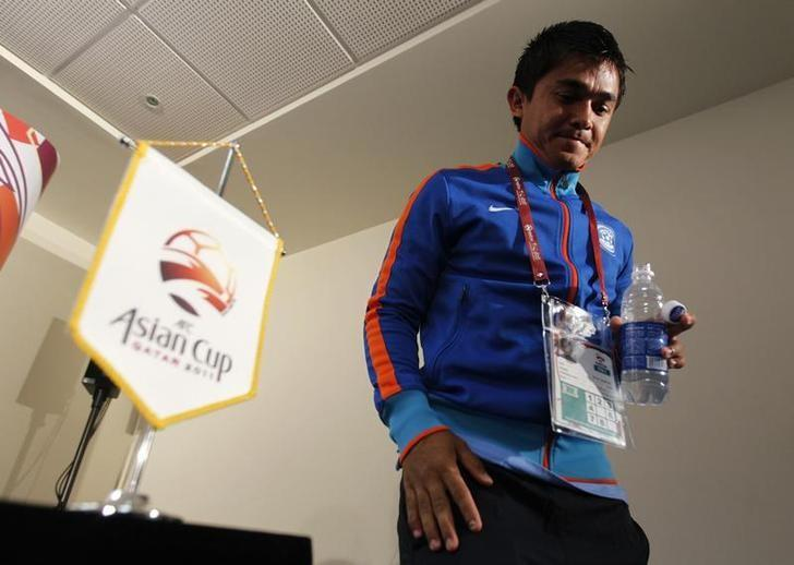Sunil Chhetri leaves after a pre-match news conference for the Asian Cup soccer tournament in Doha January 9, 2011.  REUTERS/Jo Yong-Hak/Files