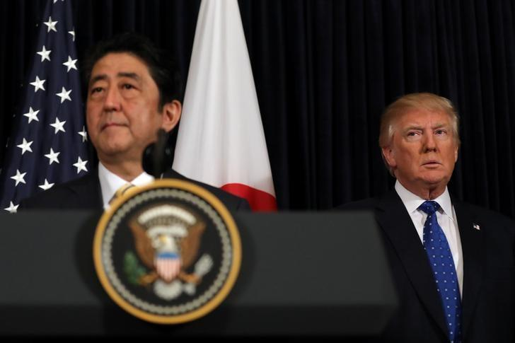 Japanese Prime Minister Shinzo Abe delivers remarks on North Korea accompanied by U.S. President Donald Trump at Mar-a-Lago club in Palm Beach, Florida U.S., February 11, 2017. REUTERS/Carlos Barria