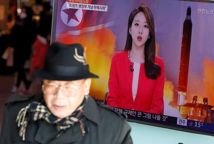 A man walks past a TV screen broadcasting a news report on North Korea firing a ballistic missile into the sea off its east coast, at a railway station in Seoul, South Korea, February 12, 2017.  REUTERS/Kim Hong-Ji