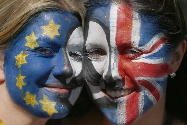 Protestors with their faces  painted pose for a photograph during a 'March for Europe' demonstration against Britain's decision to leave the European Union, in central London, Britain July 2, 2016. REUTERS/Neil Hall