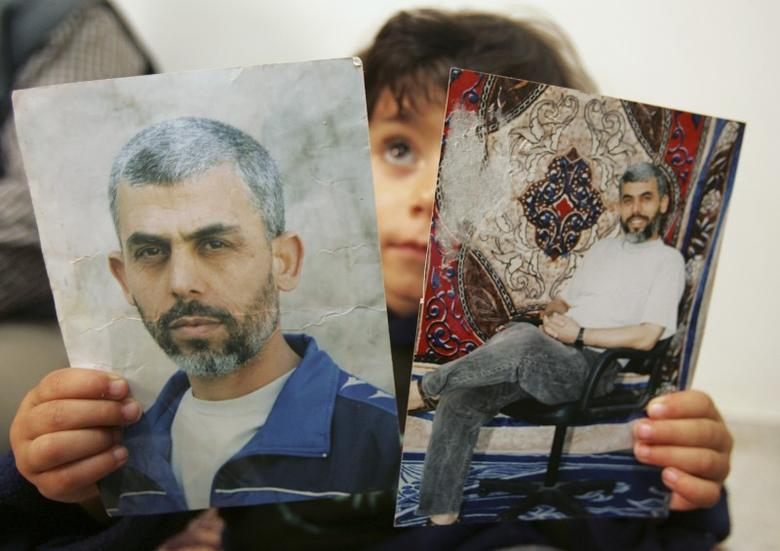 A relative of Yehya al-Sinwar, a top Hamas armed commander whose name was among other name of Palestinian faction leaders Hamas wants freed within a possible prisoner swap with Israel, poses with his picture at his home in the southern Gaza strip April 8, 2007. REUTERS/Mohammed Salem/File Photo
