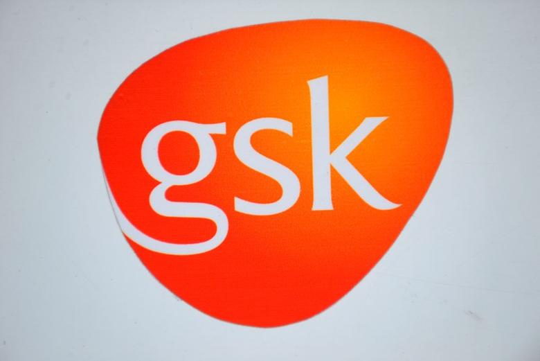A GlaxoSmithKline logo is seen outside one of its buildings in London, Britain, February 6, 2008. REUTERS/Toby Melville/File Photo