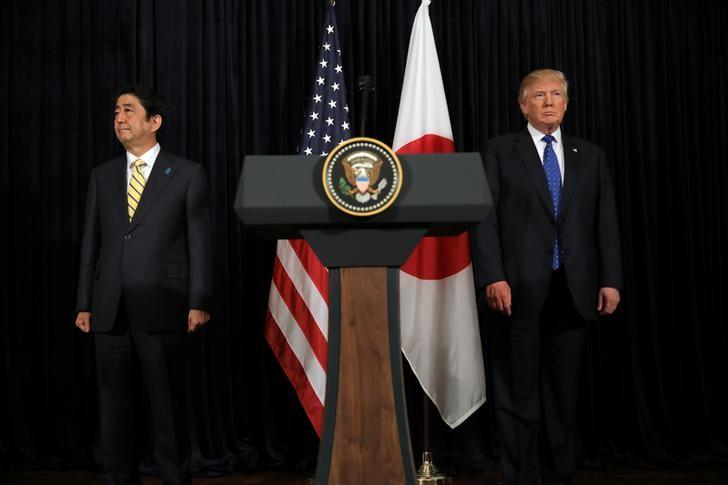 U.S. President Donald Trump and Japanese Prime Minister Shinzo Abe leave after delivering remarks on North Korea at Mar-a-Lago club in Palm Beach, Florida U.S., February 11, 2017. REUTERS/Carlos Barria