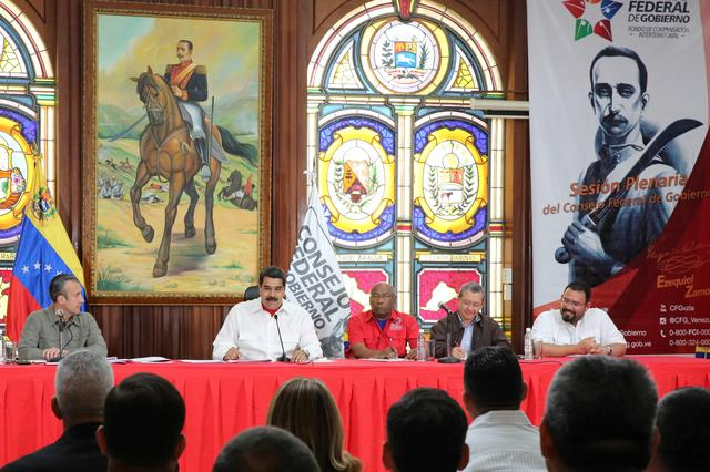 Venezuela's President Nicolas Maduro speaks next to Venezuela's Vice President Tareck El Aissami (L) during a meeting with governors in Caracas, Venezuela February 14, 2017. Miraflores Palace/Handout via REUTERS