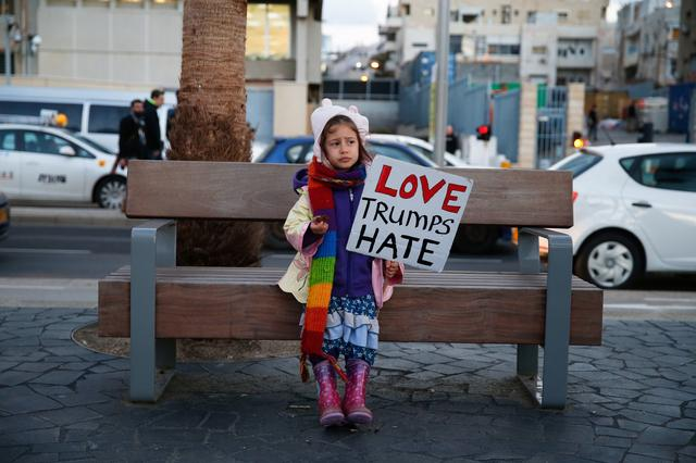 A young girl holds a placard during a protest against the meeting between U.S. President Donald Trump and Israeli Prime Minister Benjamin Netanyahu in Washington, outside the U.S. embassy in Tel Aviv, Israel February 15, 2017. REUTERS/Baz Ratner