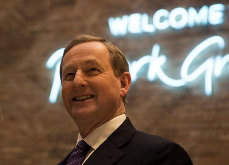 Ireland's Prime Minister Enda Kenny smiles during his visit to Primark's Spanish flagship store in Madrid, Spain January 12, 2017. REUTERS/Sergio Perez