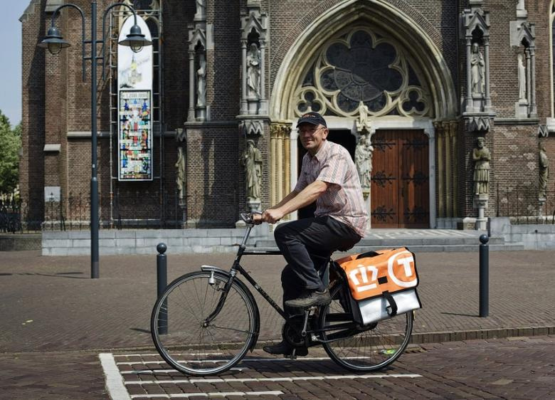 Postnl employee Jaap Bouwmans rides his bicycle to work in his hometown Veghel May 20, 2011.  REUTERS/ Jerry Lampen