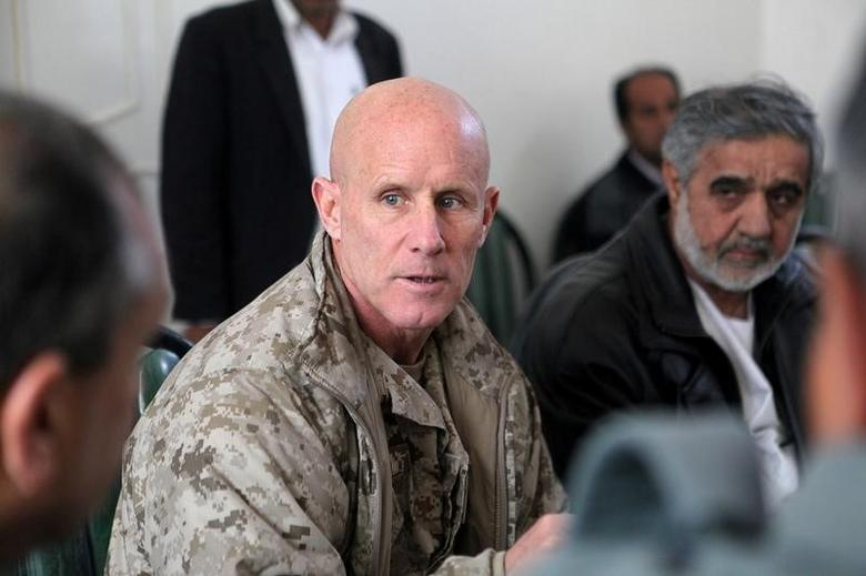 Vice Adm. Robert S. Harward, commanding officer of Combined Joint Interagency Task Force 435, speaks to an Afghan official during his visit to Zaranj, Afghanistan, in this January 6, 2011 handout photo.    Sgt. Shawn Coolman/U.S. Marines/Handout via REUTERS  ATTENTION EDITORS - THIS IMAGE WAS PROVIDED BY A THIRD PARTY. EDITORIAL USE ONLY - RTSYTT4