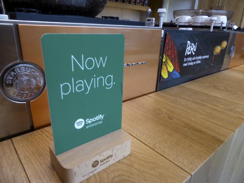 Start-up Soundtrack Your Brand, which has music streaming service Spotify as one of its investors, has a sign displayed in a Starbucks cafe in Stockholm, Sweden, April 6, 2016. Picture taken April 6, 2016. REUTERS/Mia Shanley