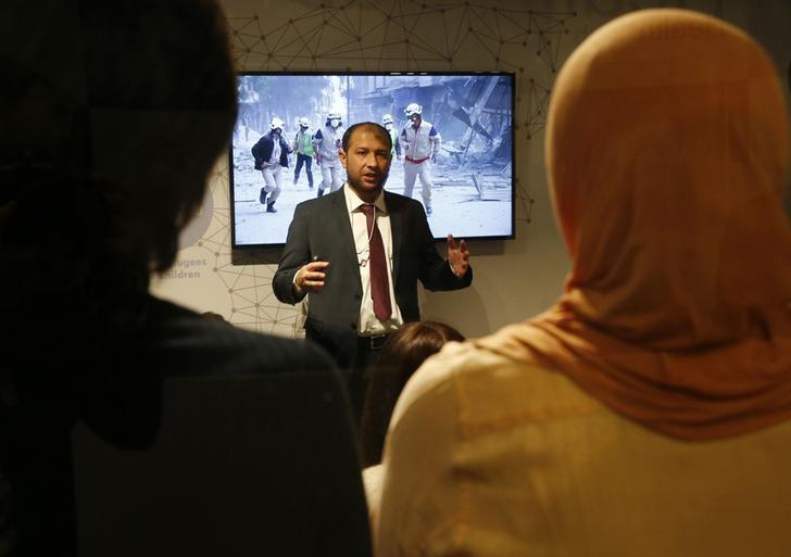 Attendees listen to Raed Saleh, Head of the White Helmets during his presentation ''What is really happening inside Aleppo?'' at the Humanitarian Hub during the World Economic Forum (WEF) annual meeting in Davos, Switzerland January 19, 2017.  REUTERS/Ruben Sprich