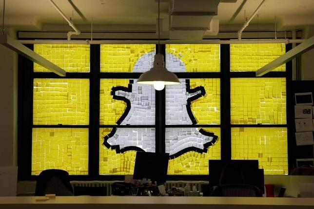 An image of the Snapchat logo created with Post-it notes is seen in the windows of Havas Worldwide at 200 Hudson Street in lower Manhattan, New York, U.S., May 18, 2016. REUTERS/Mike Segar/Files