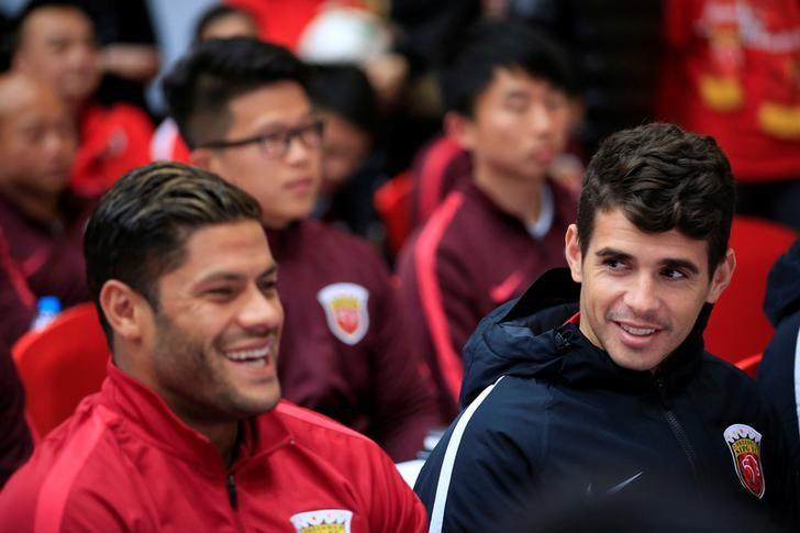 Brazilian soccer players Hulk (L) and Oscar attend the 2017 SIPG Football Club's season mobilization of the Chinese Super League, in Shanghai, China February 13, 2017. REUTERS/Aly Song