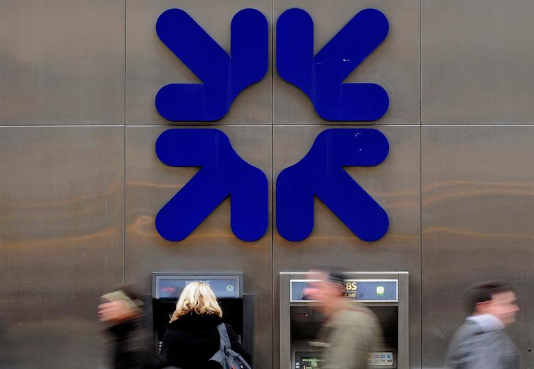 FILE PHOTO:  A woman uses an ATM at a Royal Bank of Scotland (RBS) branch in London, Britain, February 25, 2010.      REUTERS/Toby Melville/File Photo