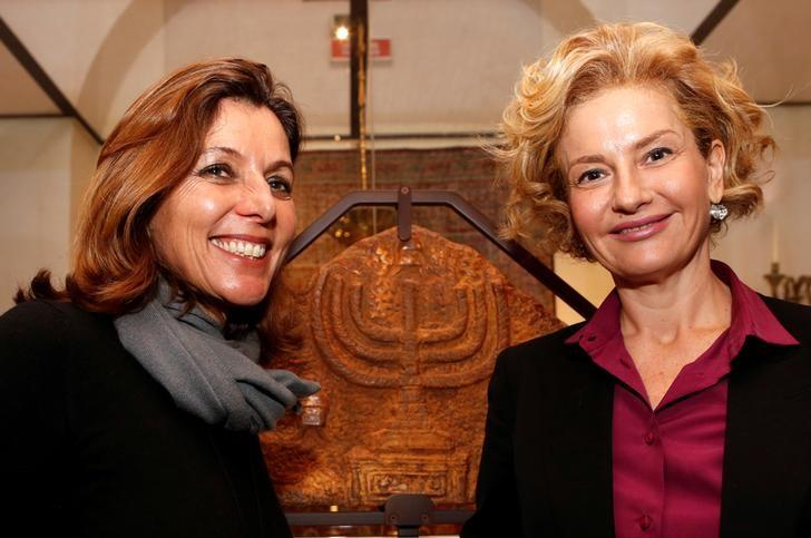 Vatican Museums Director Barbara Jatta (L) and Head of Rome's Jewish Museum Alessandra Di Castro (R) pose during a news conference where they presented an exhibition on the menorah, the ancient symbol of Judaism, at the Jewish Museum in Rome, Italy February 20, 2017. REUTERS/Alessandro Bianchi