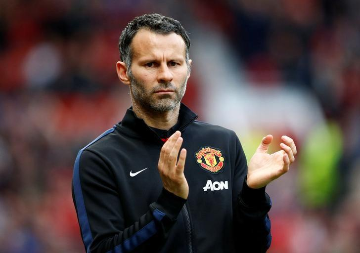 Manchester United's interim manager Ryan Giggs reacts during their English Premier League soccer match against Hull City at Old Trafford in Manchester, northern England May 6, 2014.    REUTERS/Darren Staples/File Photo