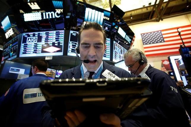 Traders work on the floor of the New York Stock Exchange (NYSE) in New York City, U.S., November 7, 2016. REUTERS/Brendan McDermid/Files