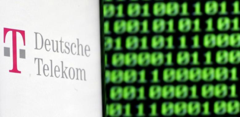 A photo illustration shows a German Deutsche Telekom logo on smartphone in front of a displayed cyber code on November 28, 2016. REUTERS/Dado Ruvic/Illustration/Files