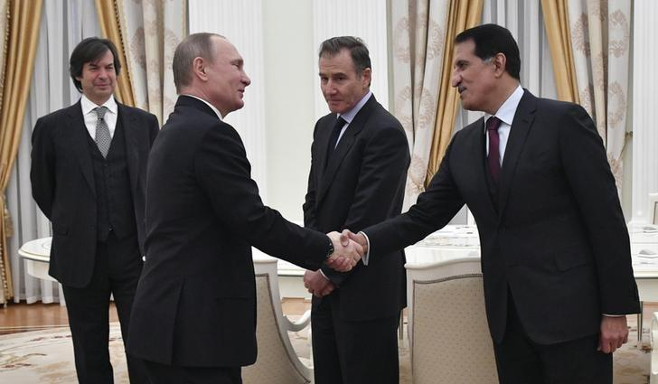 Russian President Vladimir Putin greets Sheikh Abdulla bin Mohammed bin Saud Al-Thani, chief executive of the Qatar Investment Authority (QIA), Glencore CEO Ivan Glasenberg and Bank Intesa CEO Carlo Messina during a meeting with participants of Rosneft privatisation deal at the Kremlin in Moscow, Russia January 25, 2017. REUTERS/Alexander Nemenov/Pool - RTSXBFR