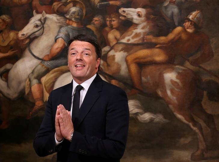 FILE PHOTO: Outgoing Italian Prime Minister Matteo Renzi gestures during the bell ceremony, to signify the start of the first cabinet meeting of the newly appointed Italian Prime Minister Paolo Gentiloni, at Chigi Palace in Rome, Italy December 12, 2016. REUTERS/Alessandro Bianchi/File Photo