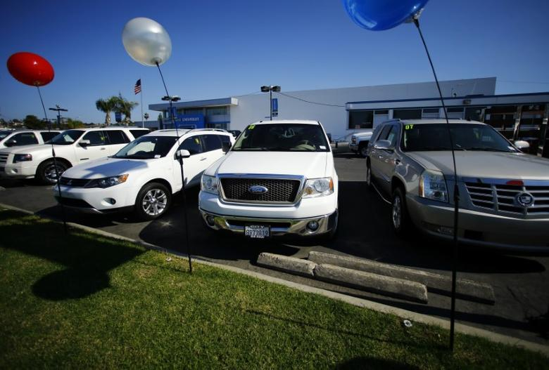Vehicles are shown for sale at a local dealership in San Diego, California November 10, 2014. REUTERS/Mike Blake