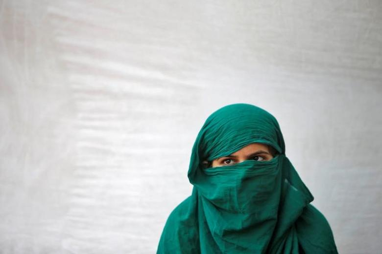 FILE PHOTO: A rape victim participates in a sit-in protest demanding justice or a right to death and hard punishment to the rapists, according to a media release, in New Delhi, India May 10, 2016. REUTERS/Anindito Mukherjee/Files