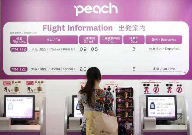 2月24日、ANAホールディングスは格安航空会社(LCC)のピーチ・アビエーションを連結子会社化すると発表した。2014年7月撮影(2017年 ロイター/Issei Kato)