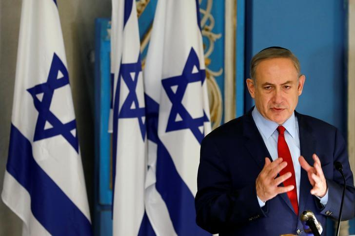 FILE PHOTO: Israeli Prime Minister Benjamin Netanyahu speaks during an event marking International Holocaust Remembrance Day, marked on January 27, at the Yad Vashem synagogue in Jerusalem January 26, 2017. REUTERS/Amir Cohen/File Photo
