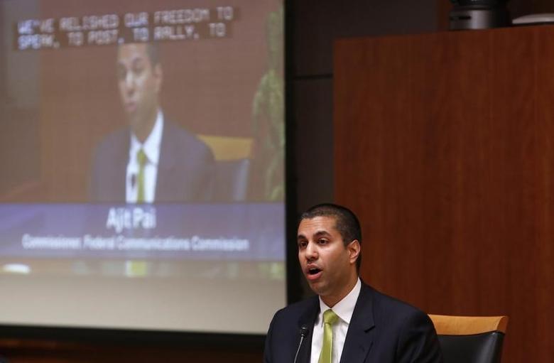 File Photo: Ajit Pai speaks at a FCC Net Neutrality hearing in Washington February 26, 2015.  REUTERS/Yuri Gripas