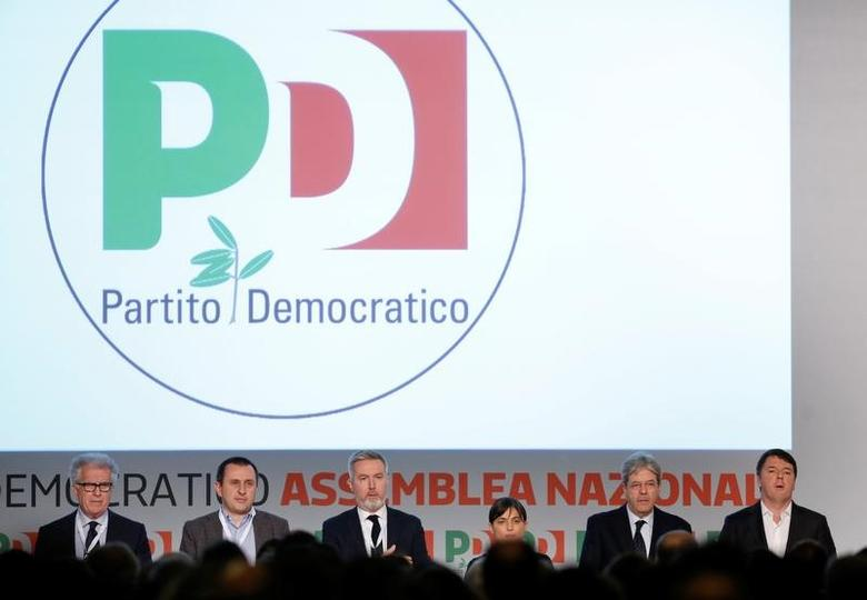 Former Italian Prime Minister Matteo Renzi (R), Prime Minister Paolo Gentiloni (2nd R) and members of the Democratic Party (PD) attend a meeting in Rome, Italy February 19, 2017. REUTERS/Remo Casilli
