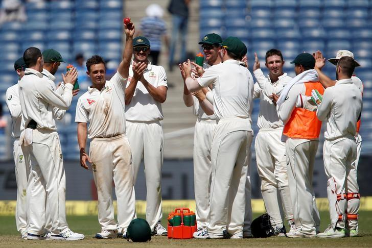 Cricket - India v Australia - First Test cricket match - Maharashtra Cricket Association Stadium, Pune, India - 25/02/17. Australia's Steve O'Keefe celebrates with team mates the wicket of India's Ravichandran Ashwin. REUTERS/Danish Siddiqui