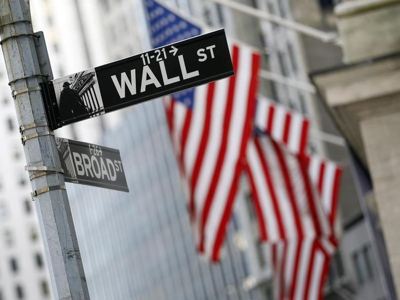 A Wall St. sign is seen outside the New York Stock Exchange, February 6, 2012. REUTERS/Brendan McDermid