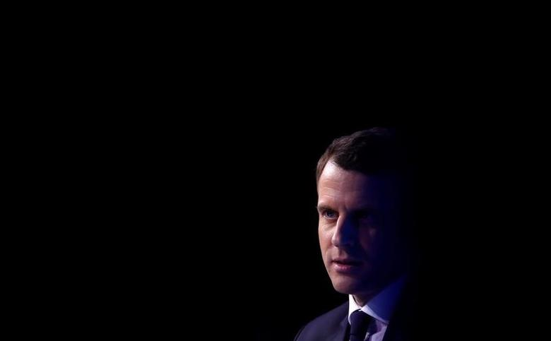 Emmanuel Macron, head of the political movement En Marche !, or Onwards !, and candidate for the 2017 presidential election, attends a meeting focused on civil works in Paris, France, February 23, 2017. REUTERS/Christian Hartmann