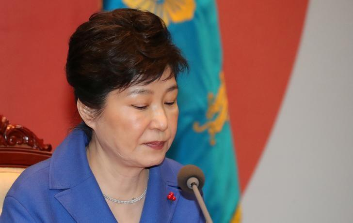 South Korean President Park Geun-hye speaks during an emergency cabinet meeting at the Presidential Blue House in Seoul, South Korea, December 9, 2016. Yonhap/ via REUTERS/Files