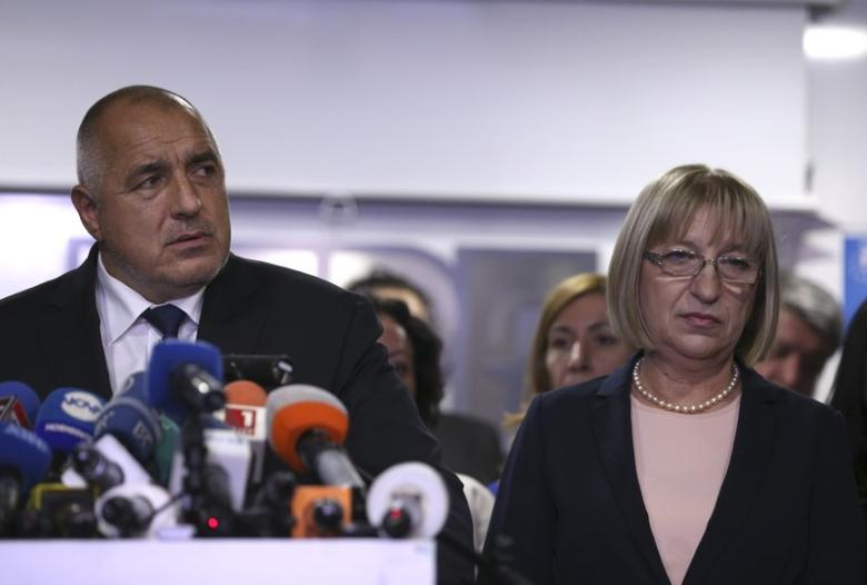 Presidential candidate for GERB party Tsetska Tsacheva and Bulgaria's Prime Minister Boyko Borissov react to the result of the exit polls during a presidential election in Sofia, Bulgaria, November 13, 2016.  REUTERS/Stoyan Nenov