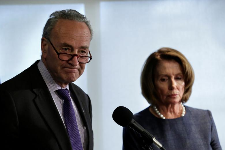 Senate Minority Leader Chuck Schumer (D-NY) (L) and House Minority Leader Nancy Pelosi (D-CA) speak at the National Press Club ahead of U.S. President Donald Trump's address to a joint session of Congress in Washington, DC, U.S. February 27, 2017. REUTERS/Yuri Gripas